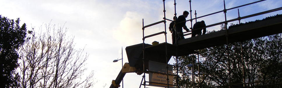 Image of Border Roofing specialists working on roof